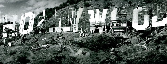 Black and white image of the famous Hollywood sign, with huge letters spelling out the name across a mountain landscape