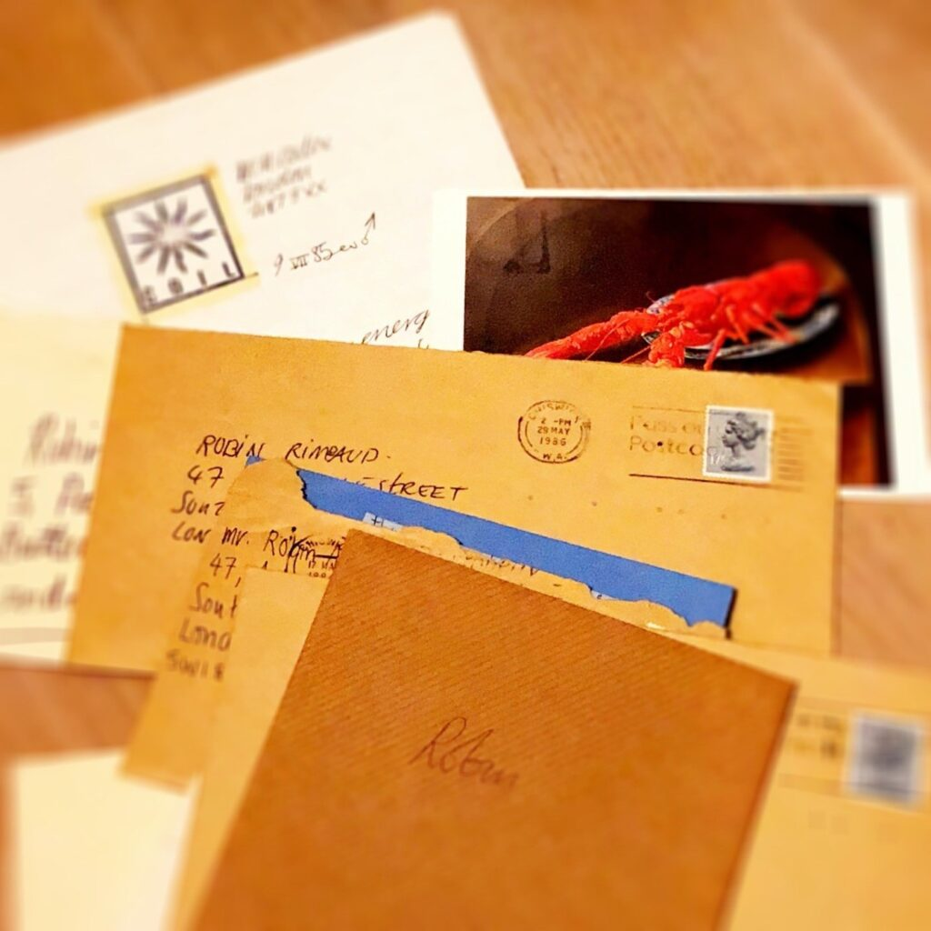 A collection of letters and cards all addressed to Robin Rimbaud, from the band Coil, with a photo of a Dali artwork featuring a lobster